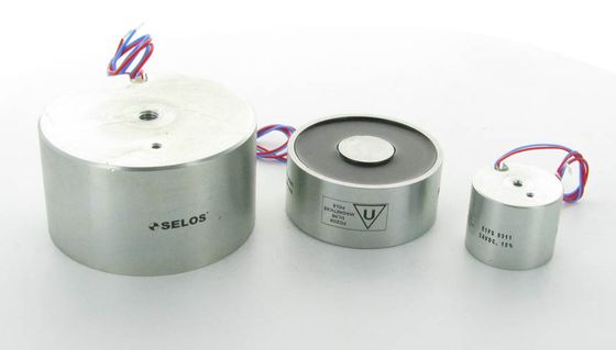 Holding solenoids with permanent magnet